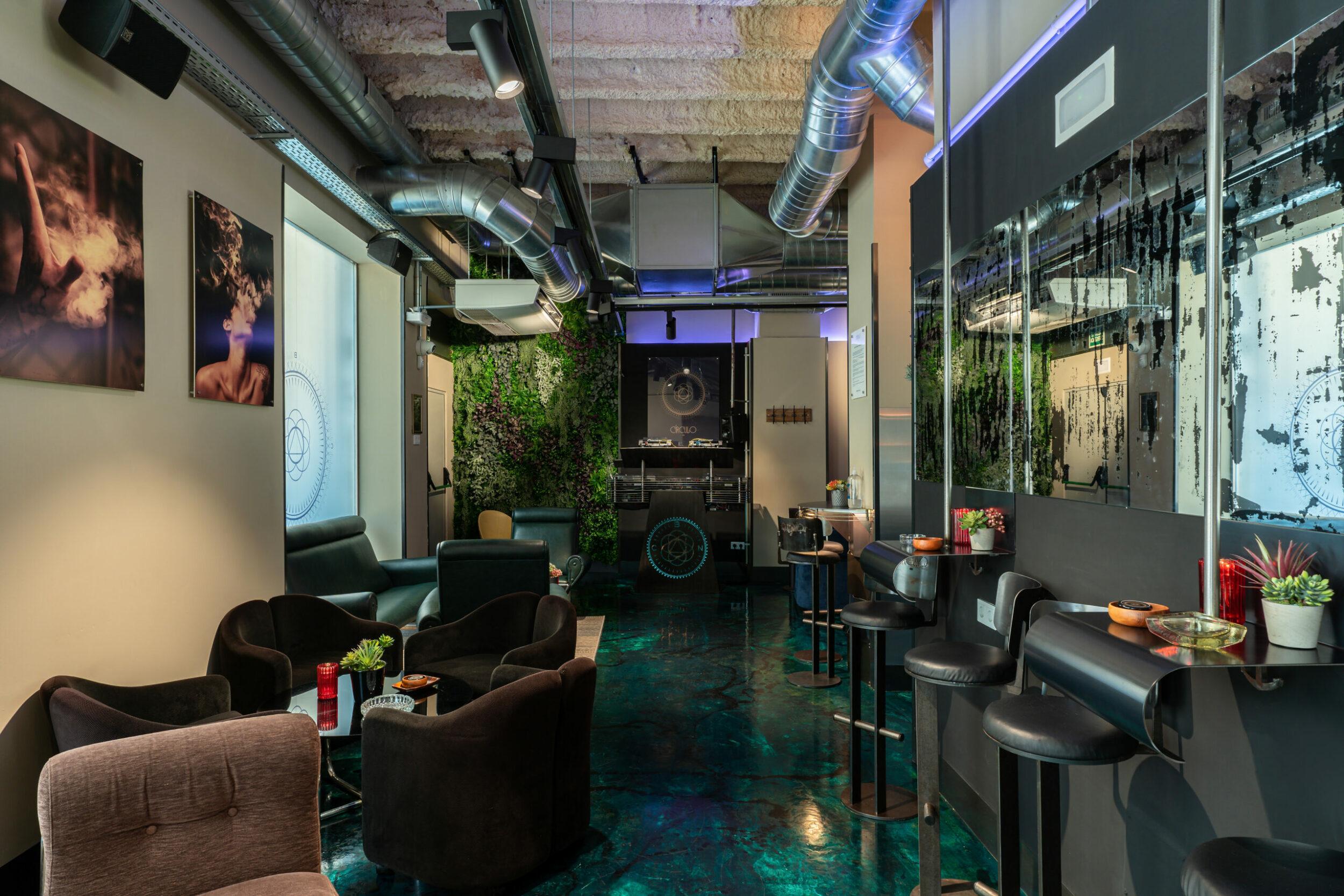 Soft sofas and a DJ console of the marijuana club